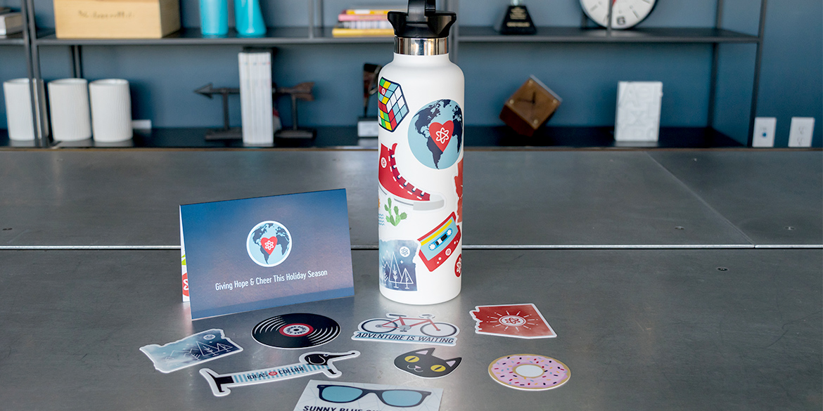 New Ideas Collide branding on water bottle and stickers